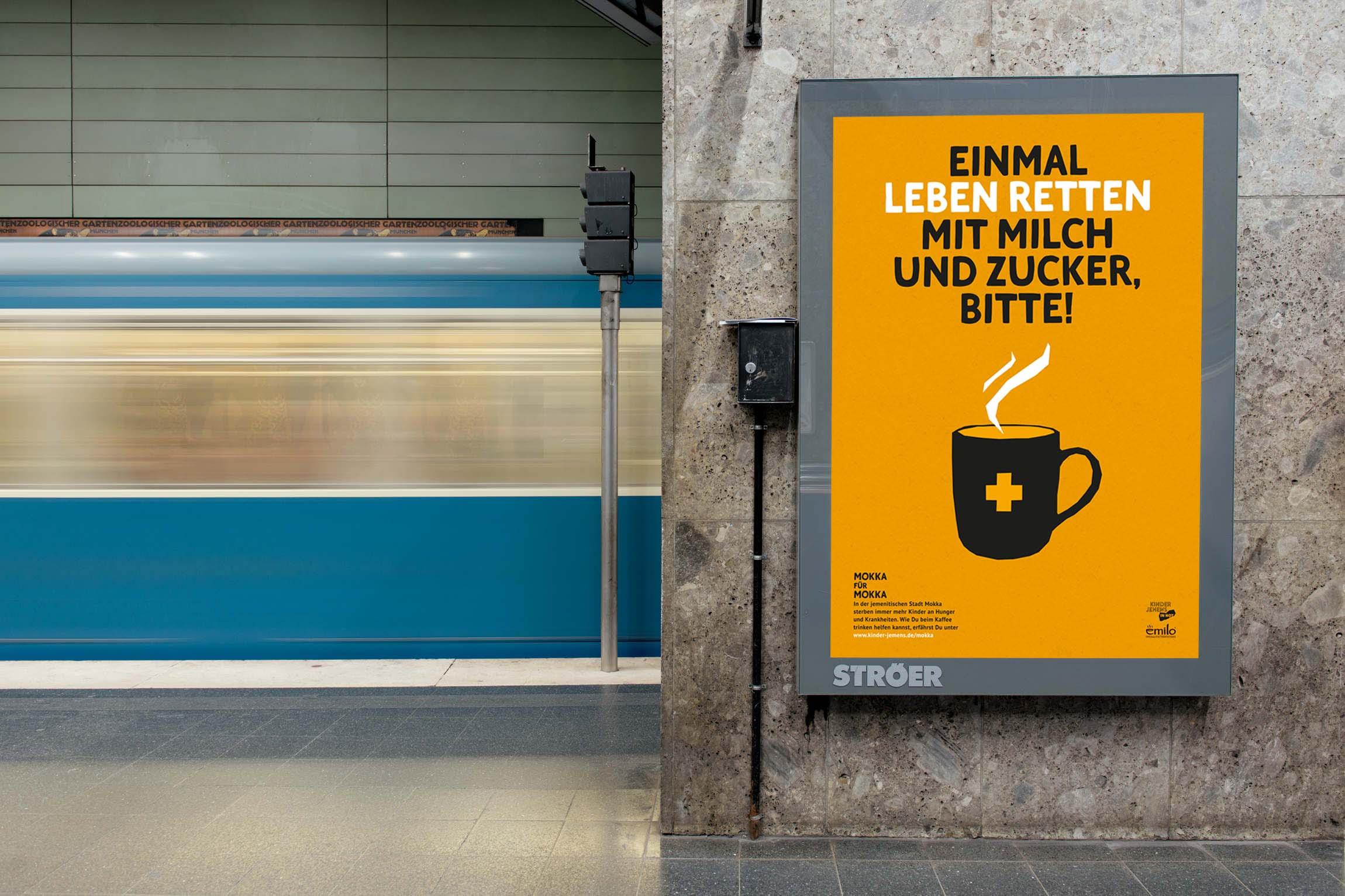 orange citylight poster in Munich underground station.