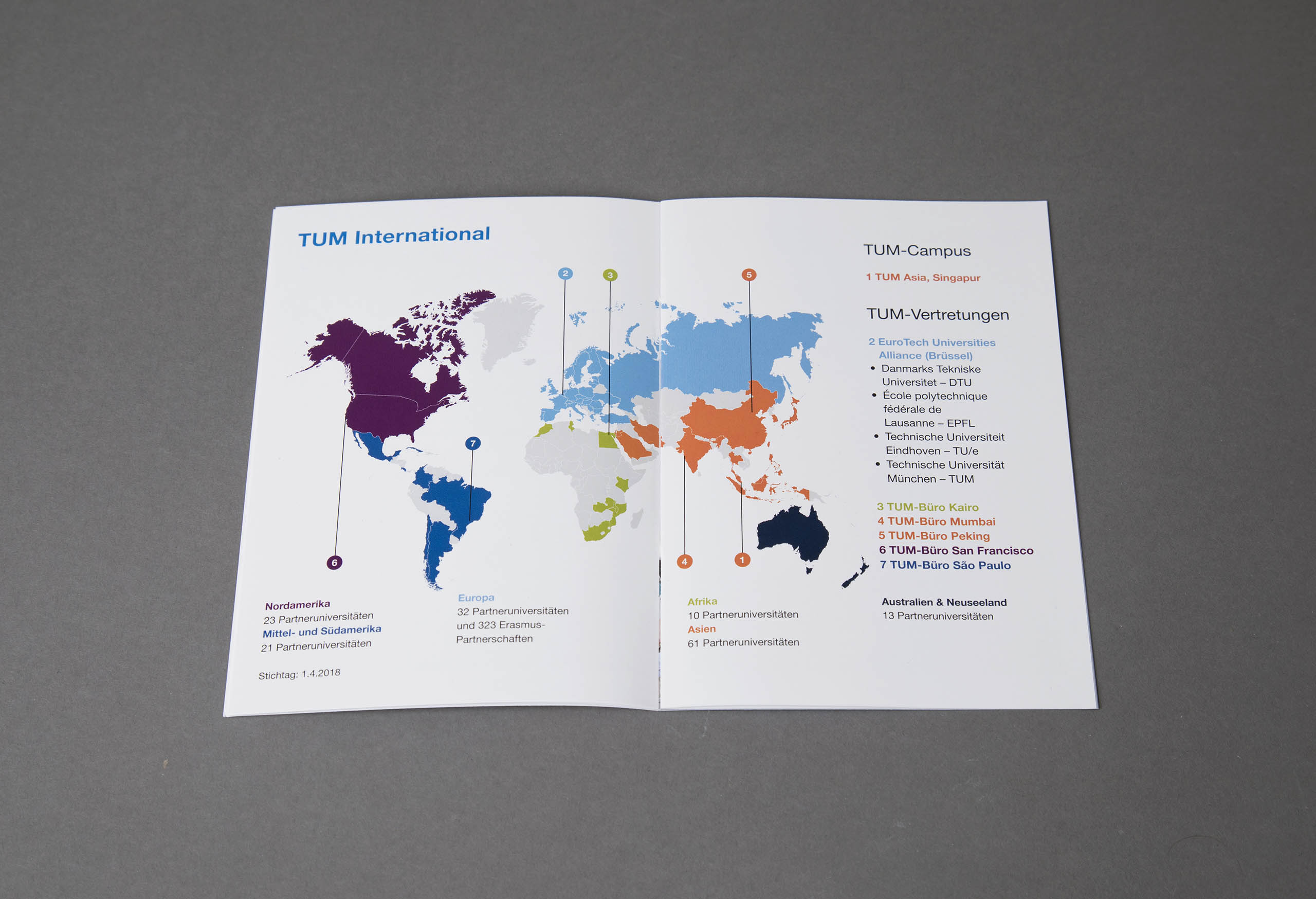 spread of brochure with map on grey background