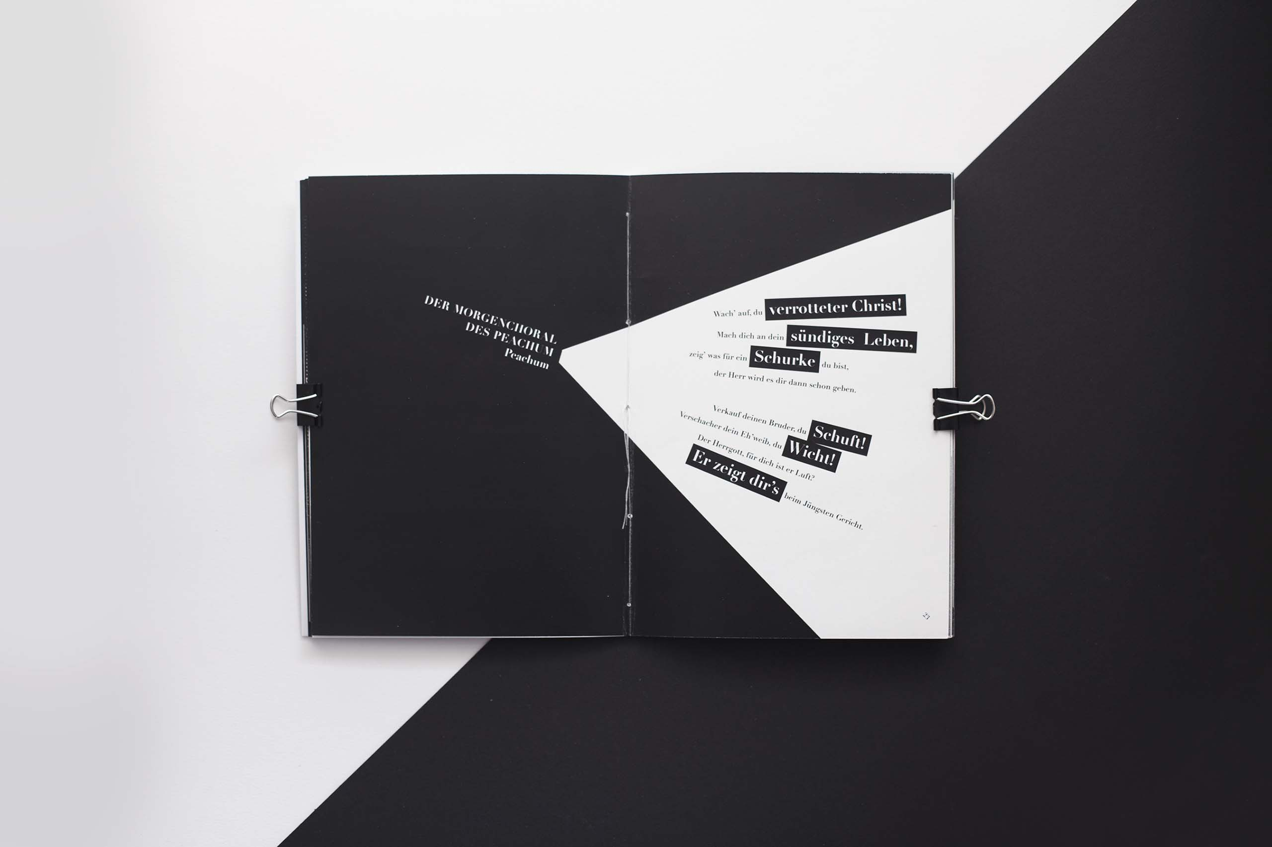 spread of black and white magazine with text