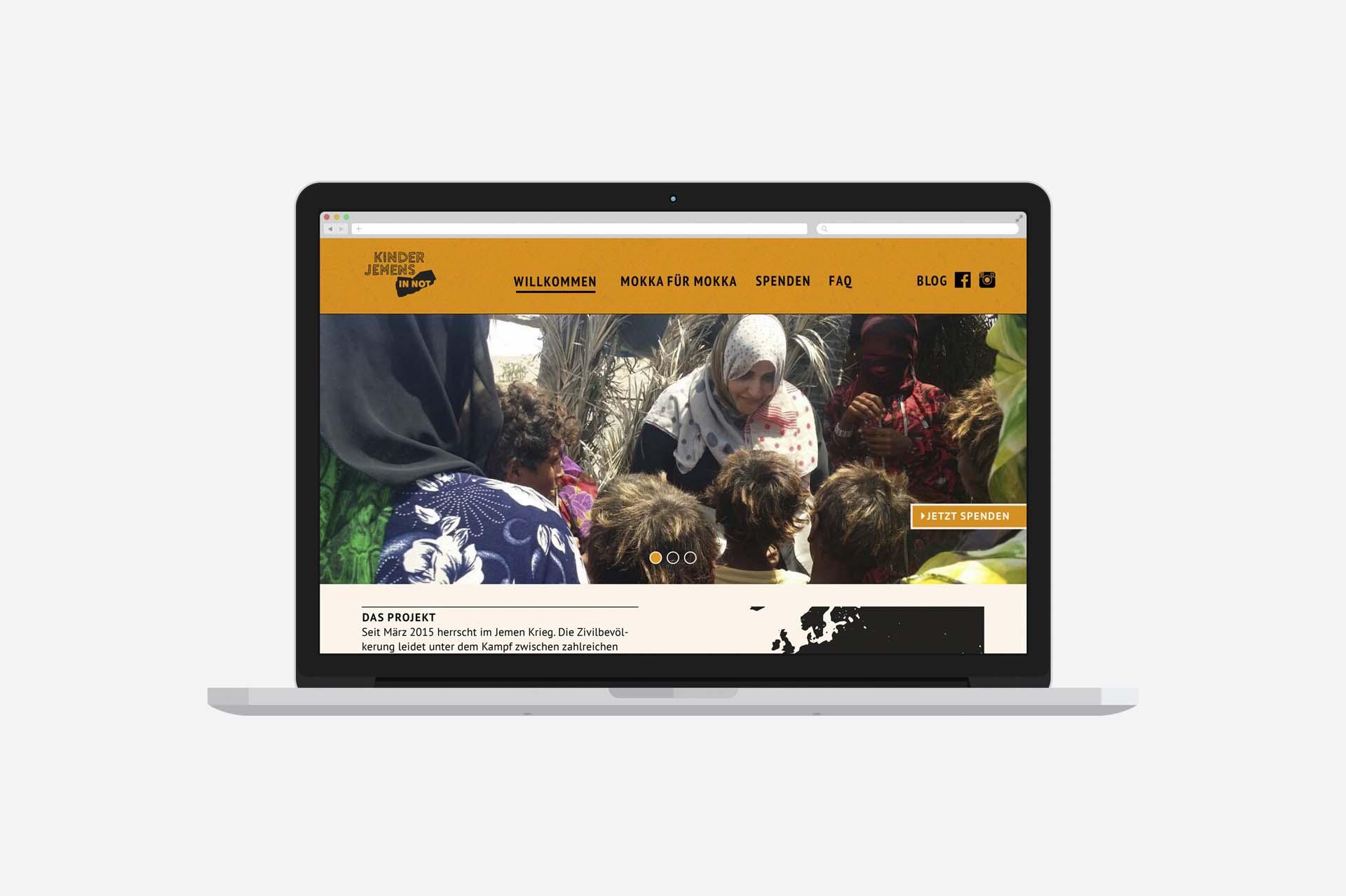 laptop website mockup of kinder jemens in not website on grey background